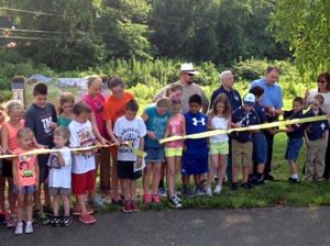 kids at a ribbon cutting ceremony