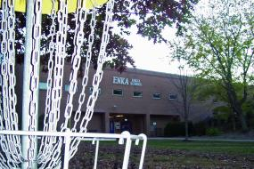 close up of a hole with enka high school in the background
