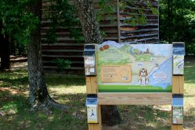 Trailhead sign with brochure