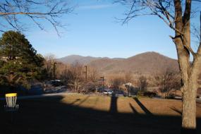 Disc golf hole with mountains in the background