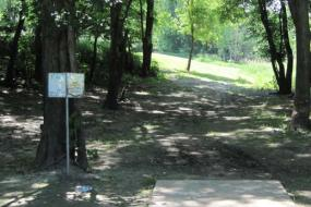 disc golf sign and the starting point for one of the holes on the course