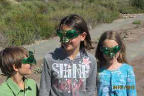 Kids wearing bug masks