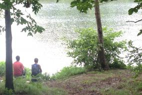 Two kids sitting by the lake