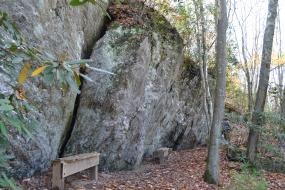 Benches by rock face