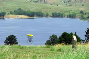 Hole on the course with the reservoir in the background