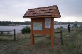 Kiosk for the course with the reservoir in the background