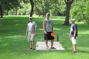 3 mean standing at the starting point for a hole on the course