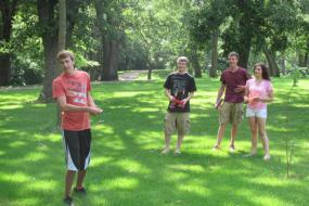 group of teenagers with discs