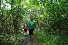 Kids hiking on wooded section of trail