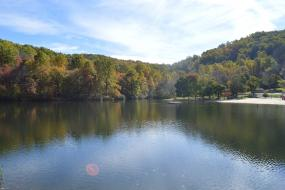 Forest surround lake in autumn