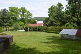 Open grassy area near barns