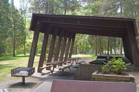 Picnic shelter with grill