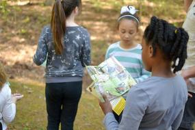 Kid using the Hide and Seek brochure