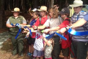 Ribbon cutting at the grand opening of the trail