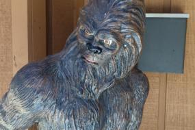 Cast bronze statue of bigfoot