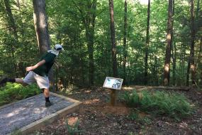 Throwing a disc off of the tee