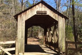 Covered wooden foot bridge