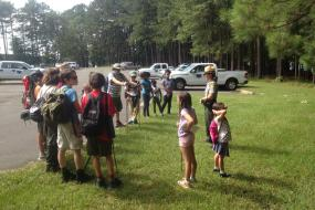 Group of kids gathered around a ranger