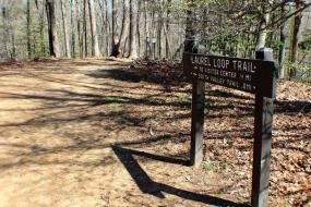 Trail distance sign beside the trail