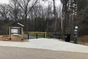 The Lindsay Pettus Greenway Trailhead from the Barr Street Learning Center parking lot.