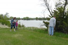 Family exploring by lake
