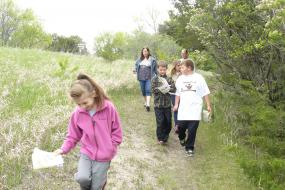 Group of kids hiking on trail