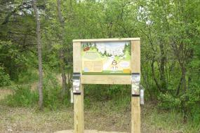 Trailhead sign with brochures