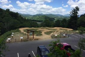 Overview shot of the pump track with mountains in the background