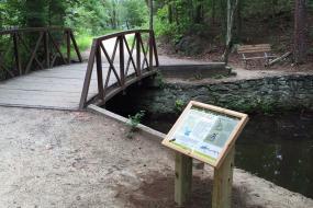Interpretive sign by bridge