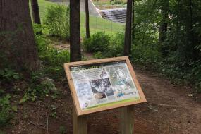 Interpretive sign by the dam