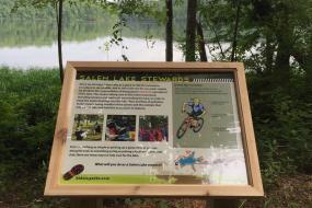 Interpretive sign about stewardship of Salem Lake