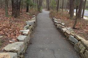 Paved path lined with rock wall