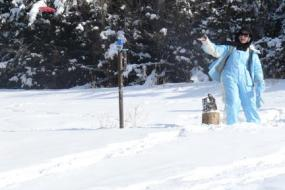Disc golfer throwing a shot in the snow